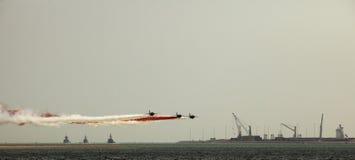 Warplanes and warships Stock Images