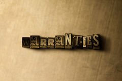 WARRANTIES - close-up of grungy vintage typeset word on metal backdrop Royalty Free Stock Photography