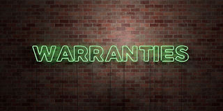 WARRANTIES - fluorescent Neon tube Sign on brickwork - Front view - 3D rendered royalty free stock picture Royalty Free Stock Image