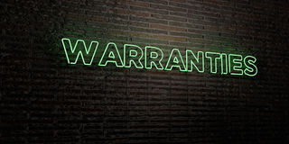 WARRANTIES -Realistic Neon Sign on Brick Wall background - 3D rendered royalty free stock image. Can be used for online banner ads and direct mailers Stock Photos