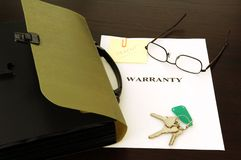Warranty file. Keys; glasses and papers Royalty Free Stock Photo