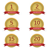 Warranty  label set. Warranty label set. Golden guarantee badges with red ribbons Royalty Free Stock Photo