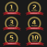 Warranty label set. Golden warranty labels. Golden badge set with laurel wreaths red ribbons Royalty Free Stock Photography