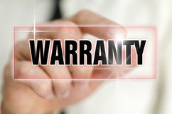 Warranty. Pressing warranty button on virtual screen Royalty Free Stock Images