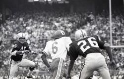 Warren McVea #6 is tackled by Dave Grayson #45. Kansas City Chiefs Warren McVea #6 is tackled by by Raiders All-Pro safety Dave Grayson #45.  Image taken from b& Stock Photo