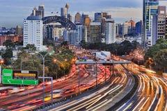 Warring Set N Syd 105mm. Long exposure blurred vehicle motion on multi-lane Warringah freeway going through North Sydney in Sydney, Australia. Headlights and Stock Image