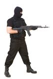 Warrior. Photo of murderer with gun attacking someone while pointing it forwards Royalty Free Stock Photography