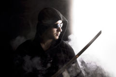 Warrior in abstract smoke on black background Stock Photography