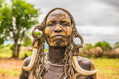Warrior from the african tribe Mursi, Ethiopia. OMO VALLEY, ETHIOPIA - MAY 7, 2015 : Warrior from the african tribe Mursi with traditional horns in Mago National Stock Photography