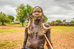 Warrior from the african tribe Mursi, Ethiopia. OMO VALLEY, ETHIOPIA - MAY 7, 2015 : Warrior from the african tribe Mursi with traditional horns in Mago National Royalty Free Stock Photo