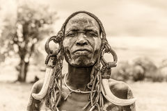 Warrior from the african tribe Mursi, Ethiopia. OMO VALLEY, ETHIOPIA - MAY 7, 2015 : Warrior from the african tribe Mursi with traditional horns in Mago National Stock Photos