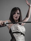 Warrior.Anime stylized brunette with short hair holding a katana Royalty Free Stock Photography
