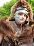 A warrior in a bear skin at the international festival Times and epochs. Ancient Rome stock photography