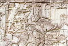 Warrior with bow and arrow on elephant bas relief Royalty Free Stock Image