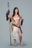 Warrior brunette girl ancient. Beautiful brunette girl in the image of ancient warrior with a spear Stock Photo