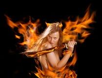 Warrior devil woman in fire Stock Photo