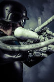 Warrior of the future with huge laser cannon shotgun over blue s. Warrior of the future with huge laser cannon shotgun royalty free stock images