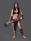 Warrior  girl ancient. Beautiful  athletic girl in the image of an ancient warrior  barbarian with axe Stock Photo