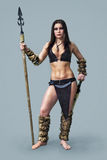 Warrior  girl ancient. Beautiful  athletic girl  in the image of ancient warrior with a spear Royalty Free Stock Photo