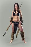 Warrior  girl ancient. Beautiful  athletic girl  in the image of ancient warrior with a spear Stock Photos