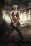 Warrior girl with a gun Stock Images