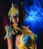 Warrior with Gold and Blue armour. 3D render of a warrior with gold and blue armour Royalty Free Stock Image