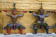 Warrior guardians in The Temple of the Emerald Buddha  complex Royalty Free Stock Image
