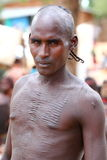Mutilation. Warrior from the Hamar tribe in Ethiopia showing his tribal marks. The amount of marks indicate the amount of killings he did Royalty Free Stock Images