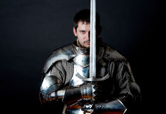 Warrior holding his great sword Stock Images