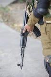 Warrior holding a Kalashnikov assault rifle. New Delhi, India Stock Photo