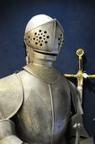 Warrior with iron armor. Sword and the warrior with iron armor Royalty Free Stock Images