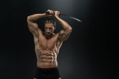 Warrior With Long Sword Over Black Background Royalty Free Stock Photography