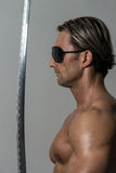 Warrior With Long Sword Over Grey Background Royalty Free Stock Photos
