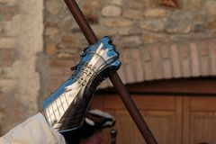 Warrior with Medieval Metallic Mitten for Hands Protection and Wooden Stick stock photography