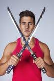Warrior with ninja swords Stock Photography