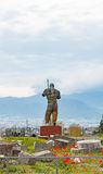 The warrior in pieces. The statue of a warrior without bits of shoulders inside the ancient ruins of Pompeii city destroyed by the Vesuvio Royalty Free Stock Image