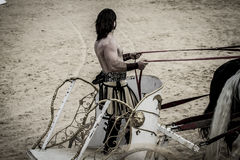 Warrior, Roman chariot in a fight of gladiators, bloody circus Royalty Free Stock Photos