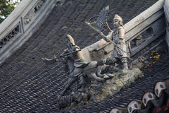 Warrior sculptures on Chinese Roof Royalty Free Stock Images