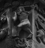 The warrior. Shot in black and white. Placed on the facade of this historic cathedral, sculpture on the capital representing a male warrior figure. Set in Royalty Free Stock Photo