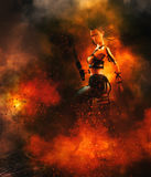 Warrior with sword in flames. 3D render of a fierce female warrior holding a sword in flames Royalty Free Stock Photos