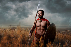 Warrior with sword and shield going in attack. stock images