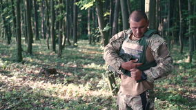 Warrior wears body armor in the forest stock video