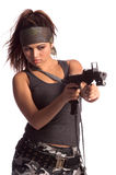 Warrior Woman. Beautiful young Latina Warrior Woman in military camo with an automatic assault weapon Stock Photo