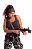 Warrior Woman. Beautiful young Latina Warrior Woman in military camo with an automatic assault weapon Stock Images
