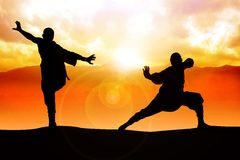 Warriors. Silhouette illustration of two figures doing martial art stance Stock Photography