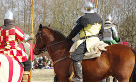Warriors in armor on horseback Stock Photos