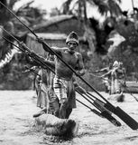 Warriors Asmat tribe are use traditional canoe. Royalty Free Stock Image