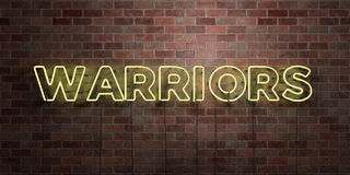 WARRIORS - fluorescent Neon tube Sign on brickwork - Front view - 3D rendered royalty free stock picture. Can be used for online banner ads and direct mailers Stock Image