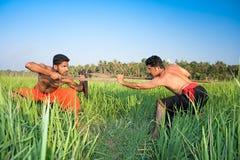 Warriors have a fight ; martial art. Warriors have a fight ;Kalarippayat, indian ancient martial art of Kerala, India stock photography