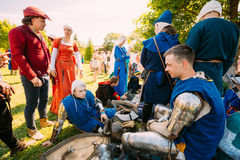 Warriors participants resting in shadow tree of VI festival of m. MINSK - JUL 19: Warriors participants of VI festival of medieval culture Our Grunwald Royalty Free Stock Image